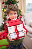 Cute festive little boy smiling at camera