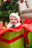 Cute baby boy in large christmas present
