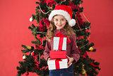 Festive little girl holding gifts