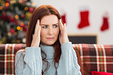Woman getting a head ache at christmas