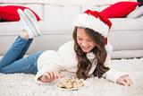 Festive little girl eating cookies
