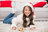 Festive little girl eating cookies