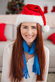 Festive redhead smiling at camera