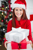 Festive redhead holding christmas gifts