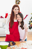 Festive mother and daughter baking together