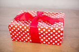 Red and white gift on table