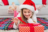 Festive little girl opening a gift