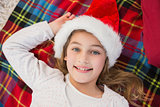 Festive little girl smiling on blanket