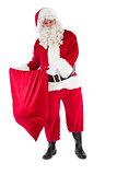 Smiling santa claus opening sack