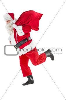 Santa claus walking with a sack
