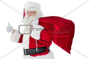 Positive santa with his sack and thumbs up