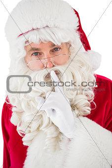 Portrait of santa keeping a secret