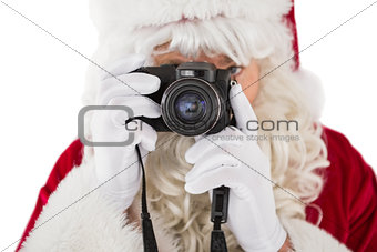 Portrait of santa taking a photo