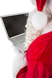 Santa claus using his laptop