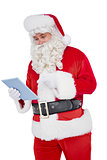 Santa claus using digital tablet