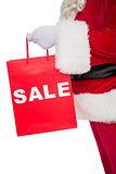 Santa claus holding sale bag