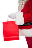 Father santa holding a shopping bag