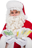 Happy santa claus showing his cash