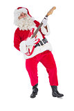 Smiling santa playing electric guitar