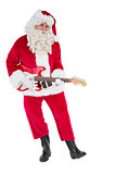 Happy santa playing electric guitar