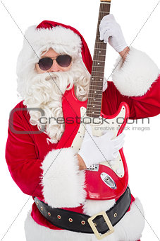 Santa with sunglasses playing electric guitar