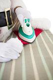 Santa claus ironing his hat