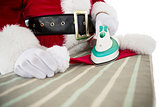 Father christmas ironing his hat