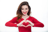 lady in red showing heart shape