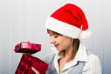 girl in the office in Santa hats with a gift