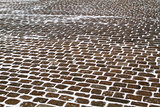 Closeup view on a cobblestone road pattern