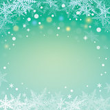 Christmas snowflakes on green background.