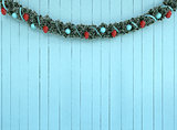 Christmas Garland Decorationon on aqua wood background