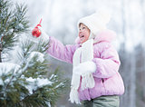 Happy kid making christmas tree decorations outdoor