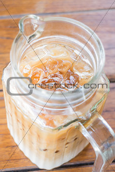 Close up iced coffee latte in glass pitcher