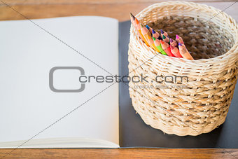 Artist sketchbook and colored pencils