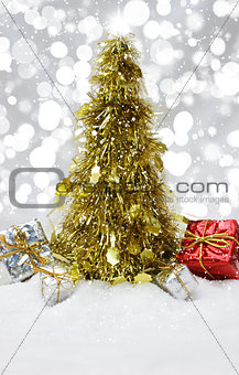 Tinsel Christmas tree in snow