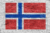 Norwegian flag over brick wall