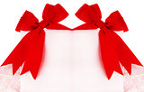 Beautiful red bows over blank card