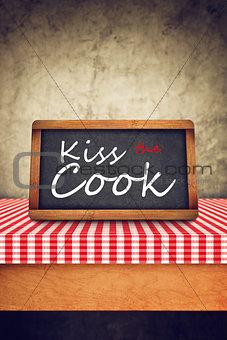Kiss The Cook Title on Restaurant Slate Chalkboard