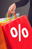 Discount Percentage Symbol on Red Shopping Bag