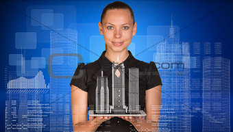 Beautiful businesswoman holding tablet pc with layouts on it. Buildings, figures. letters and diagram as backdrop