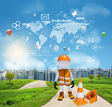 Three-dimensional worker standing on road running through green hills. City of tall buildings as backdrop. World map and other virtual items in sky