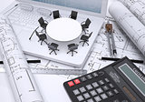 Miniature round table with chairs placed on laptop, calculator and few other tools