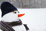 snow man standing close up