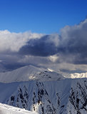 Snow mountains and blue sky with clouds