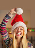 Portrait of smiling teenager girl in santa hat
