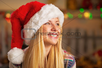 Portrait of smiling teenager girl in santa hat