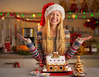 Portrait of happy teenager girl in santa hat with christmas cook