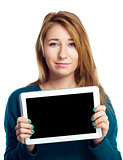 Young cheerful woman is showing blank tablet