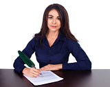 Portrait of a cheerful business woman sitting on her desk and sign up contract on white background